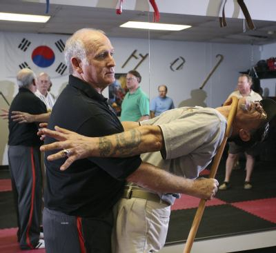 The old man is doing self defense.
