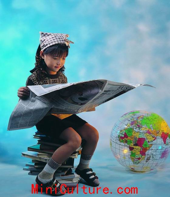 Girl Reading Newspaper to Learn the World