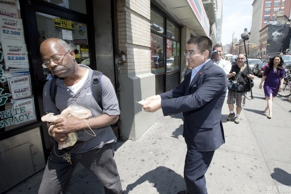 Chen Guangbiao Hands Out Money on New York Street